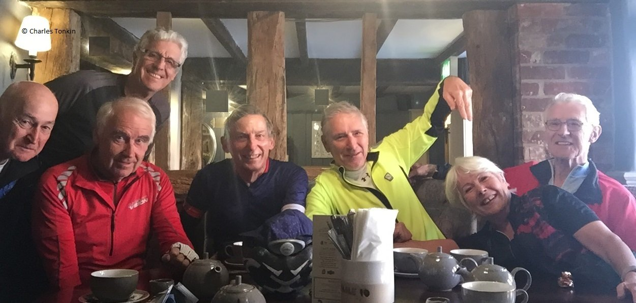 Photo of seven cyclists at the coffee stop